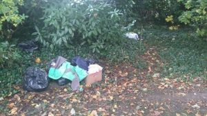 The rubbish left strewn in the Cemetery's bushes Pic: David Hudson