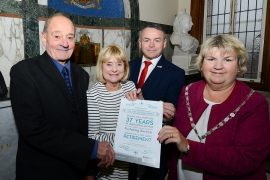 George and Jos Hindle being presented with an award for their services to fostering from Chairman of the County Council, Cllr Janice Hanson and Cllr Tomlinson at a ceremony at County Hall