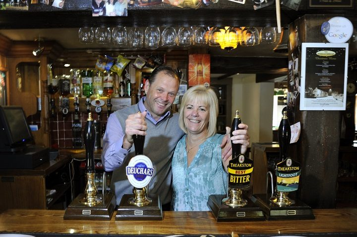 Pete and Ness behind the bar at The Wheatshead