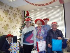 Some of the Charlotte House regulars with the Christmas bags