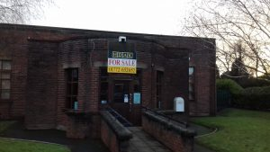 Fulwood library with the 'for sale' sign