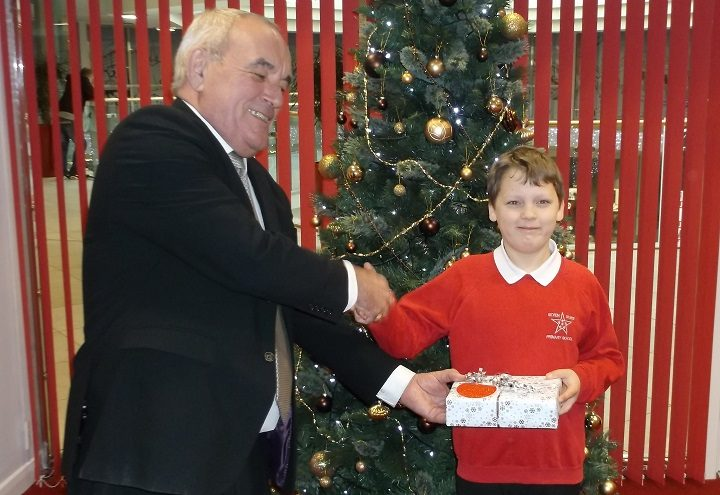 Kiyan receives an iPad from Jim at the St George's Shopping Centre