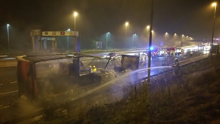 Smouldering wreck of the lorry on the hard shoulder of the M6