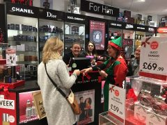 The Christmas elf pops up in The Perfume Shop