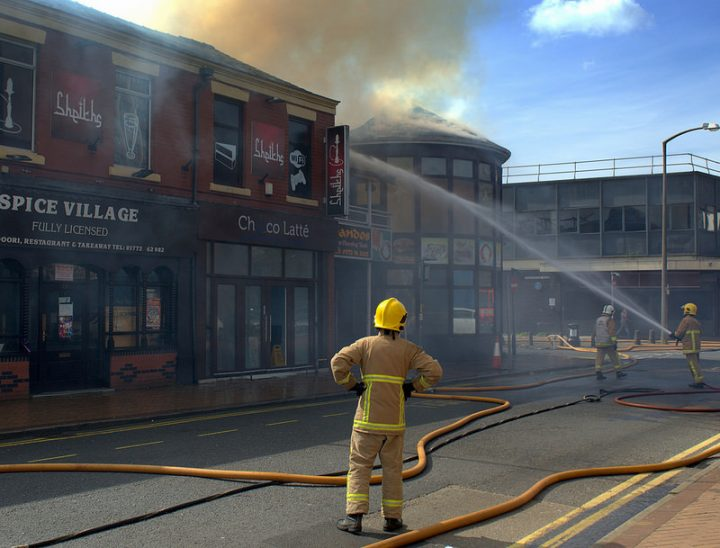 Firefighters in action dealing with a fire at a takeaway in Preston city centre Pic: Tony Worrall