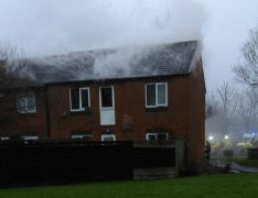 Smoke billows from the upstairs flat in Tag Croft