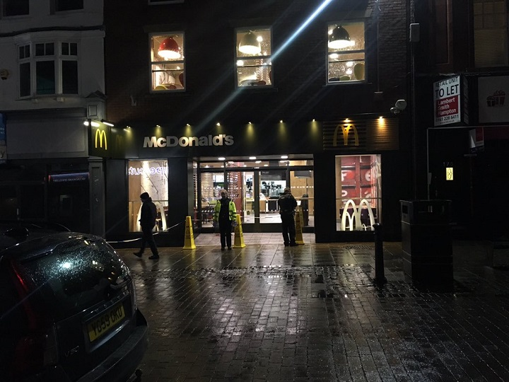 Police outside McDonalds in Preston Pic: Benjamin Wareing