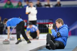 Tom in action at the VoIP World Junior Curling Championships 2017