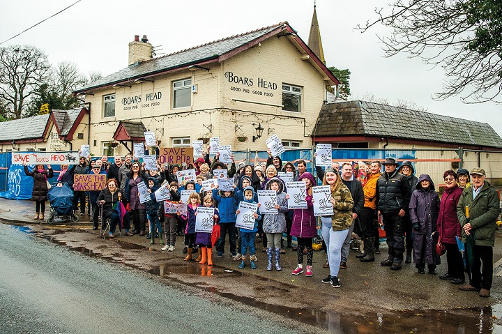 Community gathers to show their support for the Boars Head