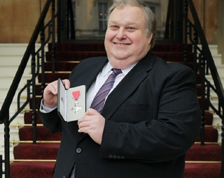 Simon Rigby with his MBE