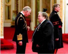 Prince Charles and Simon Rigby share a word