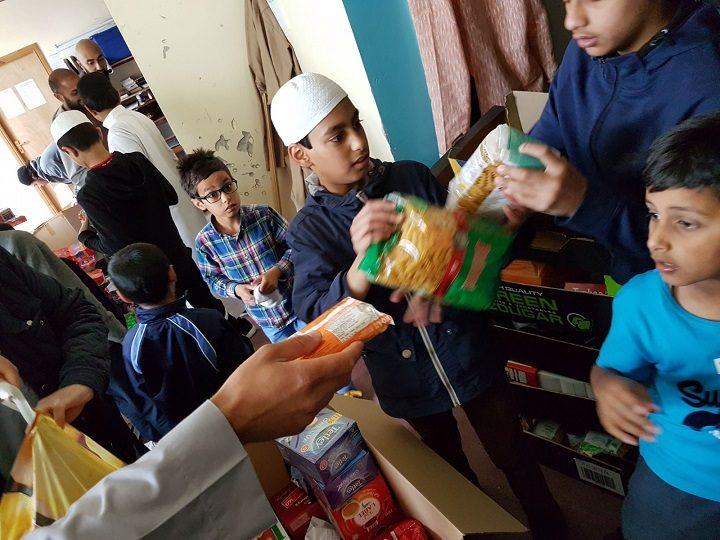 Volunteers helping to sort the food donated