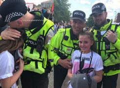 Poppy at the One Love concert - with at the time - two mystery police officers
