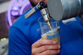 Pouring an ale at Hopfest