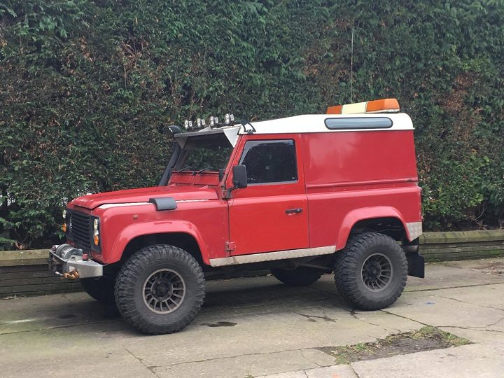 The distinctive red Landrover