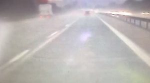 The car can barely be seen in the rain Pic: LancsRoadPolice