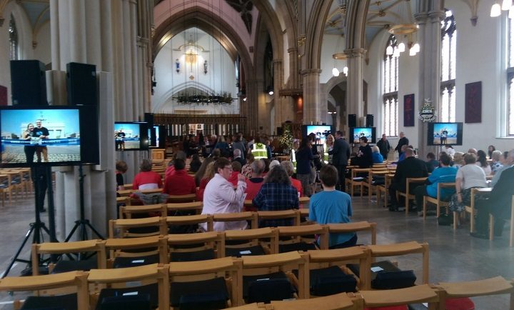 The screens set up for those at the celebration service to Ben Ashworth