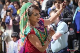 A dancer entertains the crowds in the sunshine