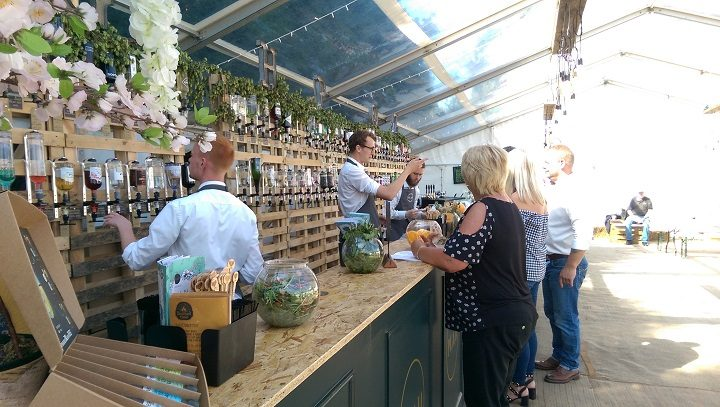 The well-stocked gin bar in the marquee