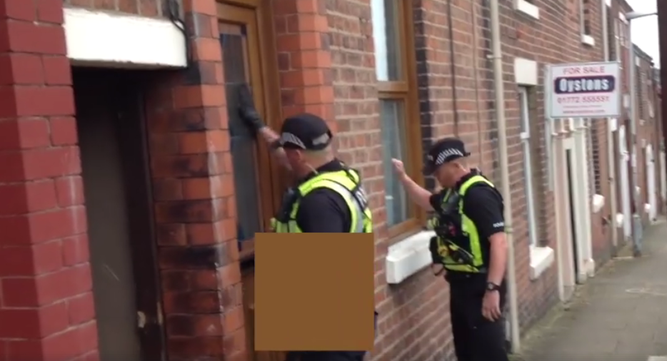 Police bang on a door as part of drugs warrants carried out in the city