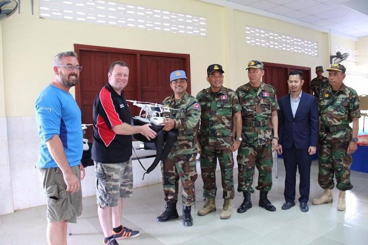 Mr Dave Severns-Jones – commercial drone pilot working with Furniture for Education Worldwide (FEW), Dr Darren Ansell – aerospace engineering lead, UCLan, Lieutenant General. Ken Sosavoeun deputy general director of NPMEC, Major General Taing Chanponloeu, director department of operation and training of NPMEC, Major General Hout Kimsan, director of school training of multi national peacekeeping forces, Mr Ratana Sem, Cambodian commercial drone pilot, Brigadier General Oung Bura, deputy director of school training of multinational peacekeeping forces