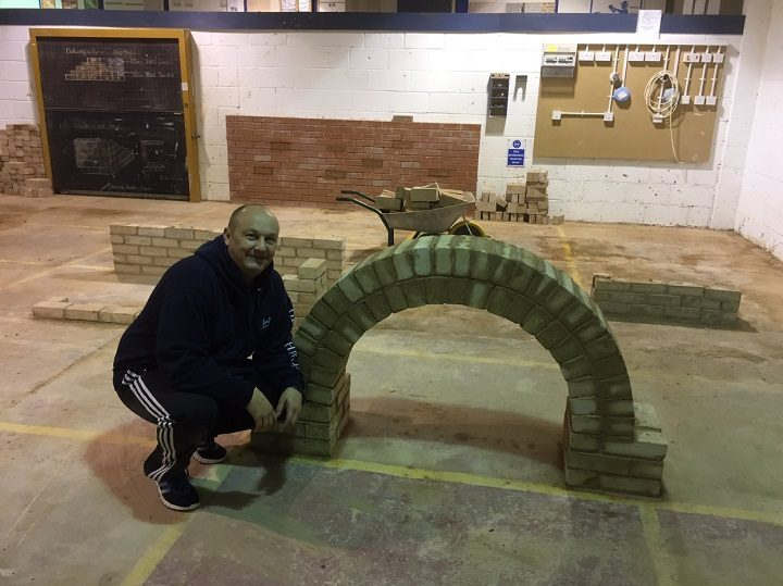The workshops include hands-on skills like this brich arch making at PVC