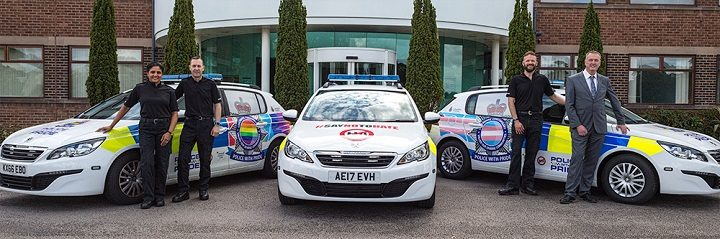Lancashire Police's deputy chief constable (far left) and police and crime commissioner (far right) with the cars