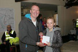 Katie after winning the 3k fun run with Conlon chairman Michael Conlon