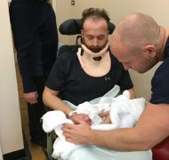 Ben meeting his niece four weeks after the attack