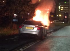 The flames leap from the bonnet of the car Pic: LancsRoadPolice