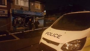 The shop in Harewood Road had a police presence throughout the early hours of Monday Pic: Shakeel Ahmed