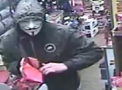 Man wearing a white Halloween mask seen in the off-licence