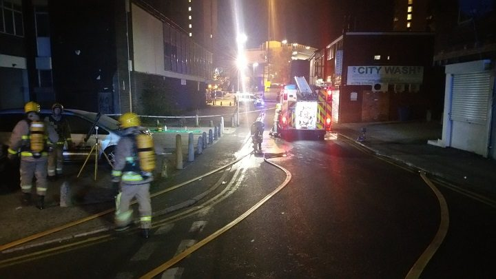 Fire crews pumping water in Manchester Road