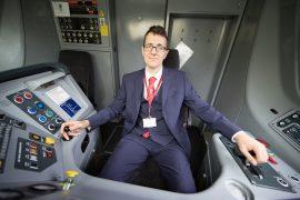 Simon in the cab of a Virgin Train