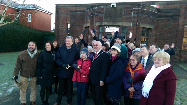 Crowd outside the library - including county councillor Geoff Driver