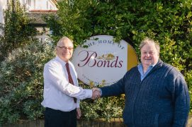 Martin Molloy and Simon Rigby agree the deal for Bonds
