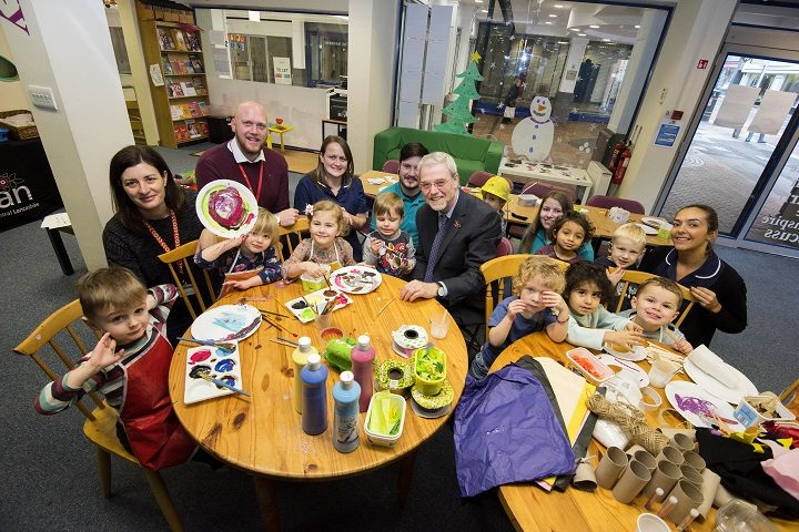 Professor Mike Thomas, centre, joined a festive craft session at In The City