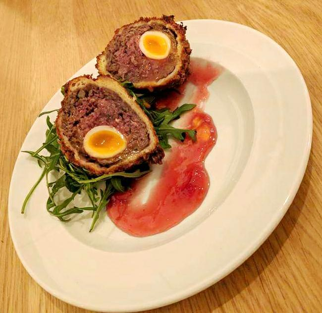 Venison scotch egg with slow gin marmalade