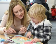 Mum Beth DeNobrega reads to her son Max aged two