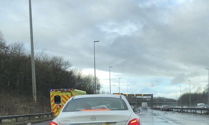 Ambulance on the scene and debris across the M6 at Preston