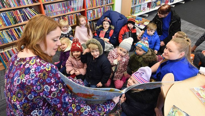 Jill Connolly, LCC reading and learning development manager, reads to children from Townley House Nursery