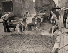 Workers lay tarmac in Church Street in 1938