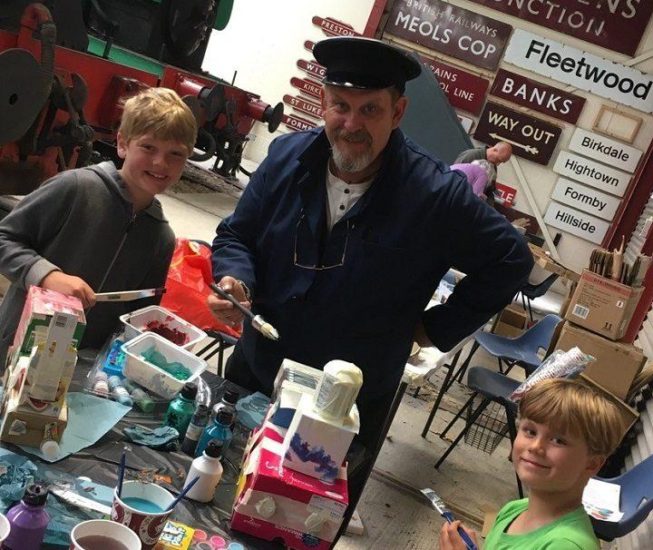 John Meredith running a kids club at the Ribble Steam Railway
