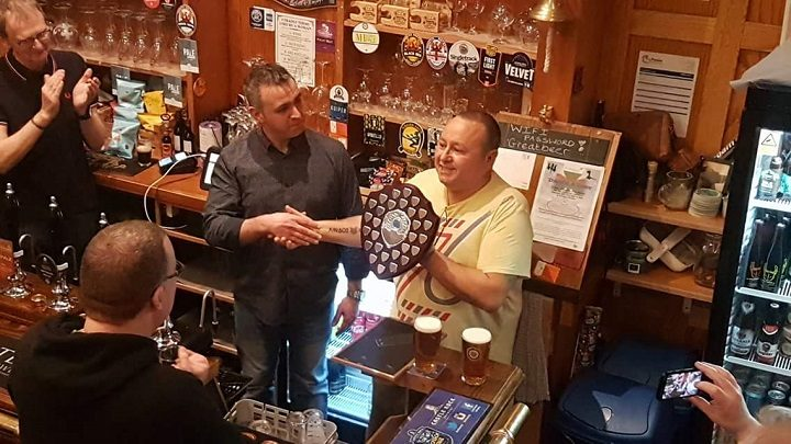 Gary receives the certificate from CAMRA