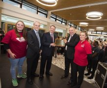 Liam Fox, centre, opens the social spaces at UCLan