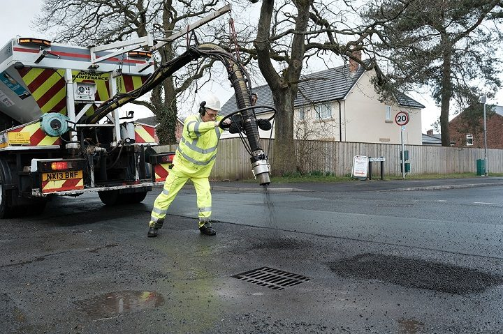 The new machine in action filling a pothole