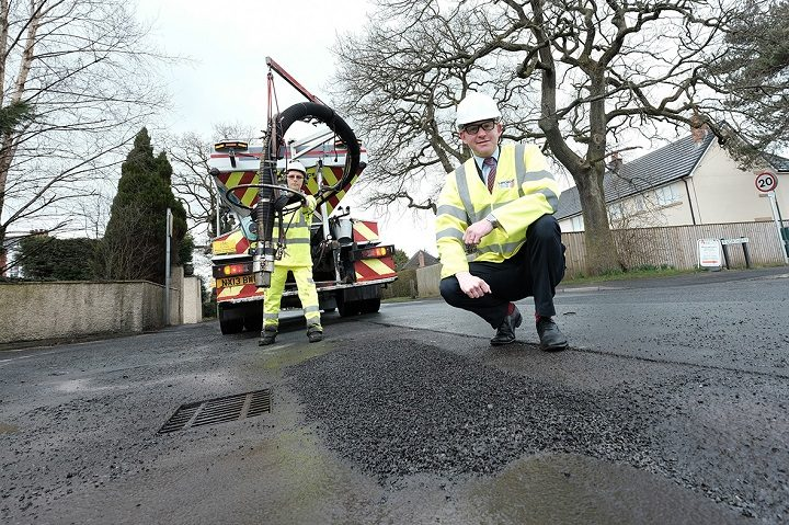 Cllr Andrew Snowden with the pothole machine