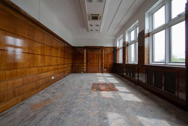 One of the former office rooms with its original panels