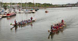 Race action at Preston Docks for the dragon boats