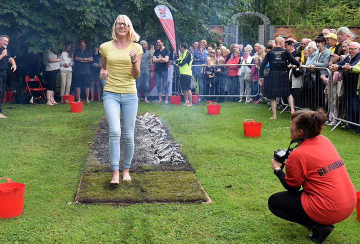 St Catherine's Hospice's sponsored firewalk returns to Yellow Day this weekend